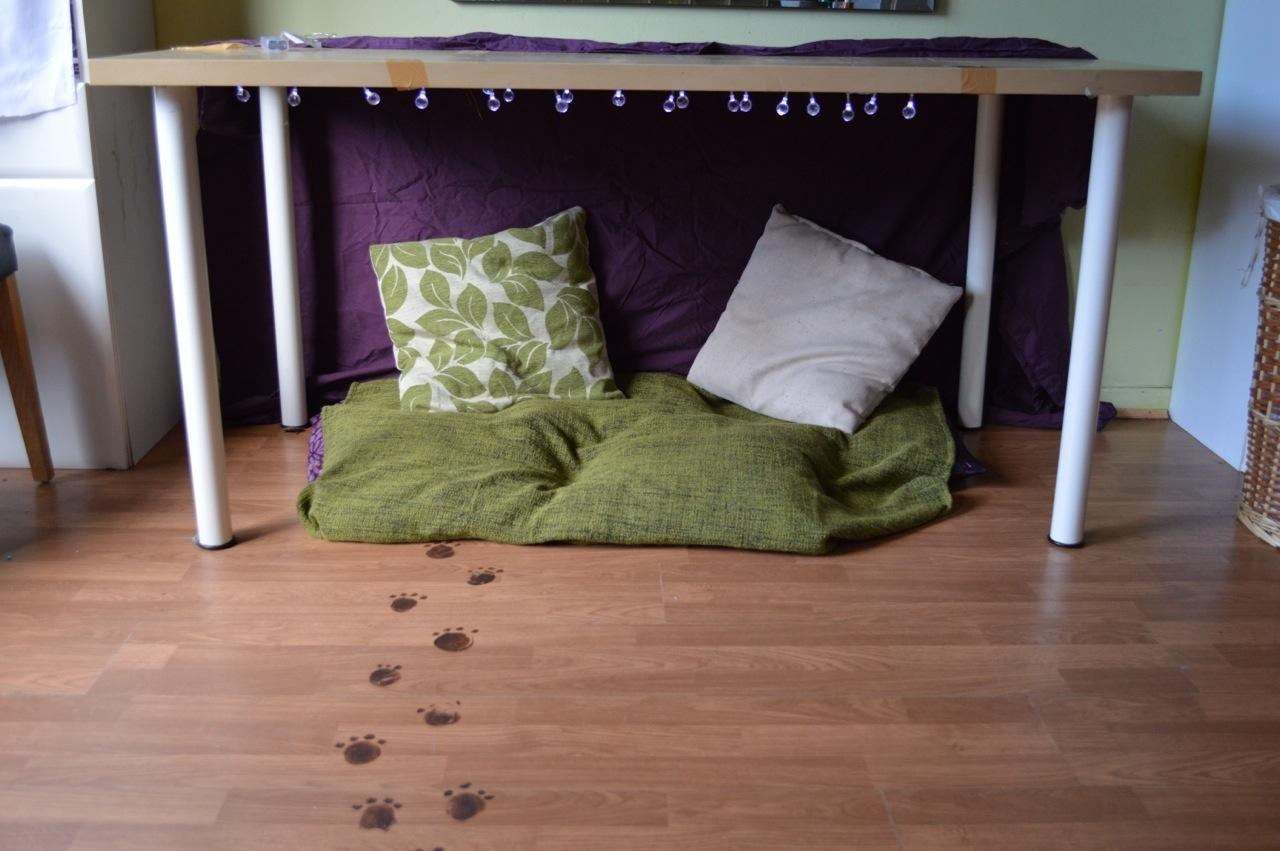 under table bear lair den